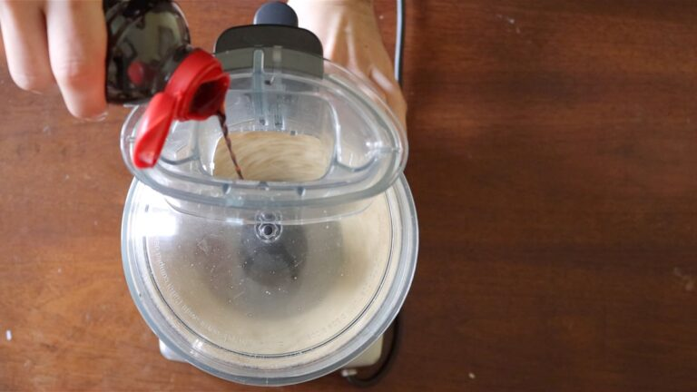 Blend the almonds in the food processor