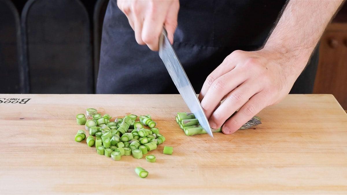 chopping the asparagus
