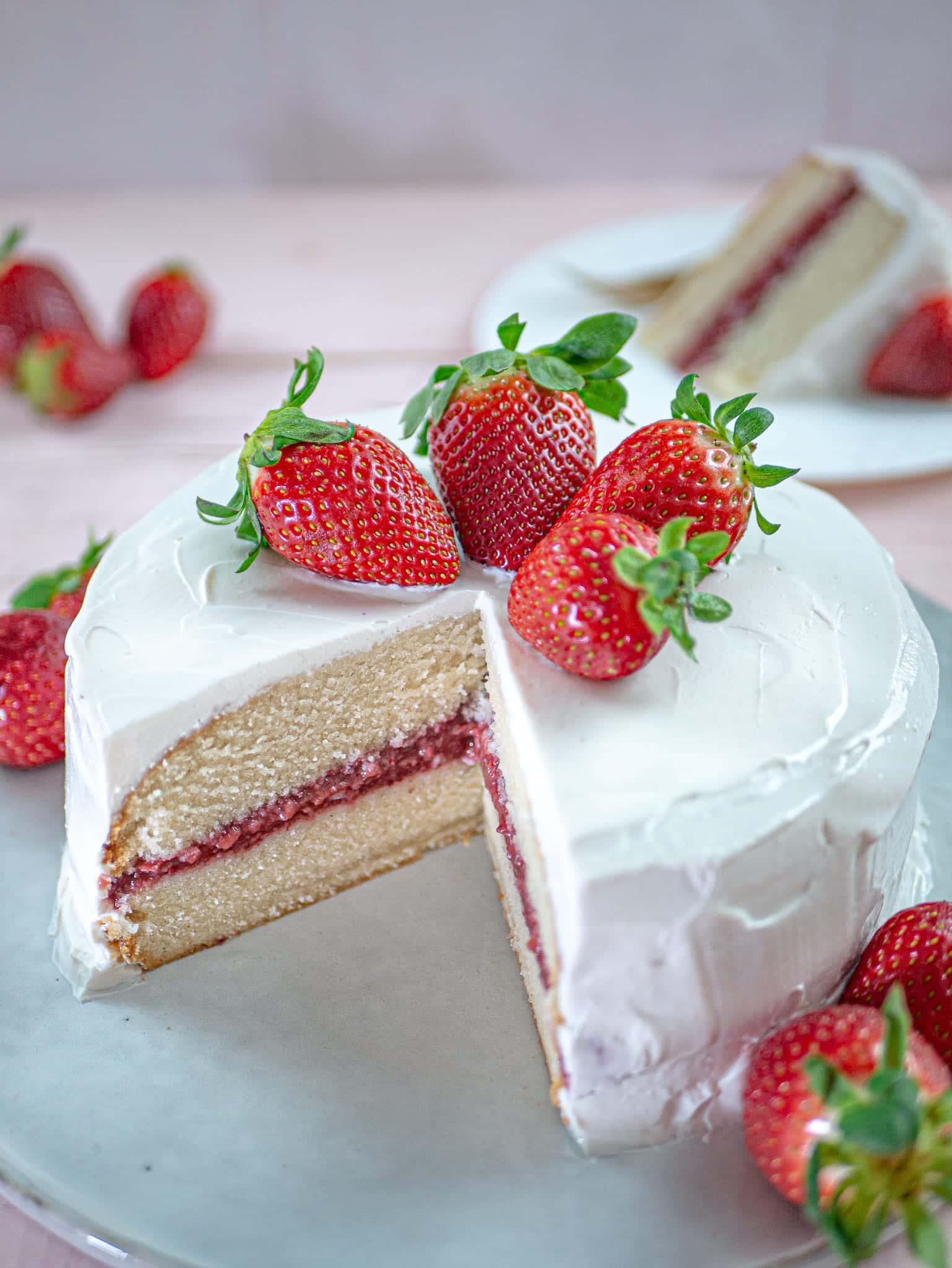 CUT OPEN VANILLA CAKE WITH STRAWBERRY JAM