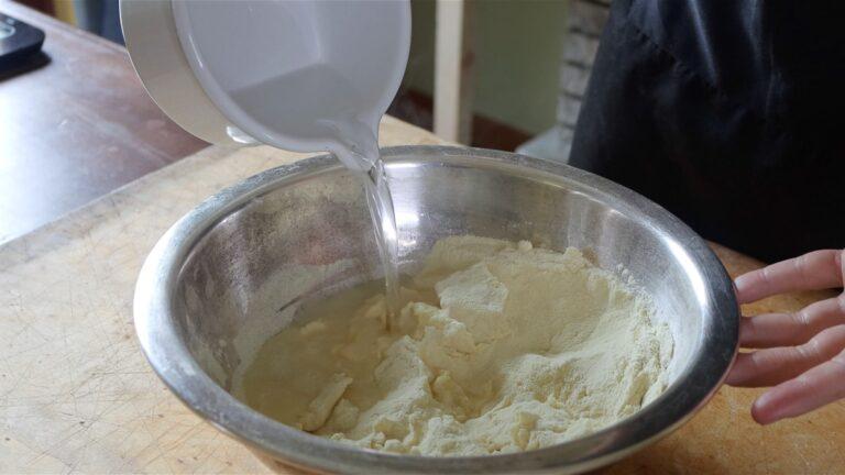 mixing water and semolina flour