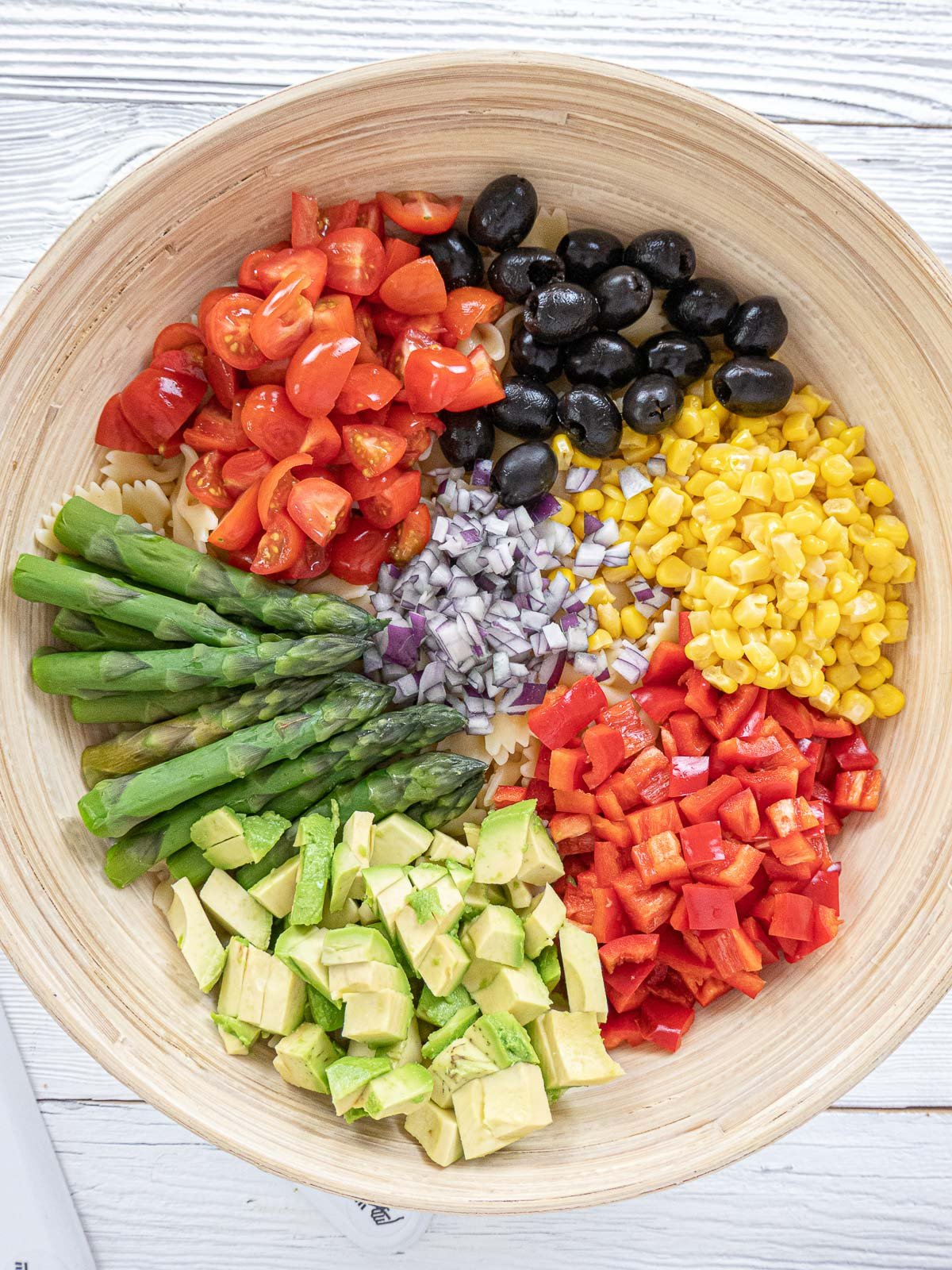ingredients for pasta salad in a bowl