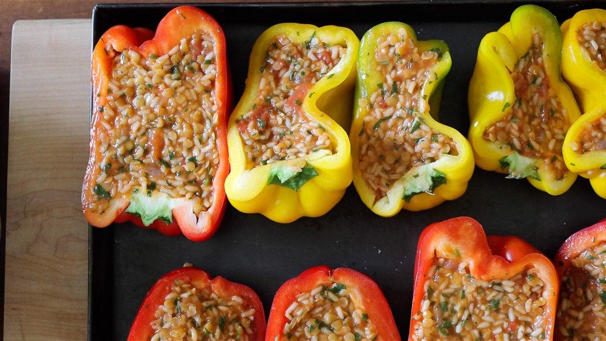 vegan stuffed bell peppers on a sheet pan