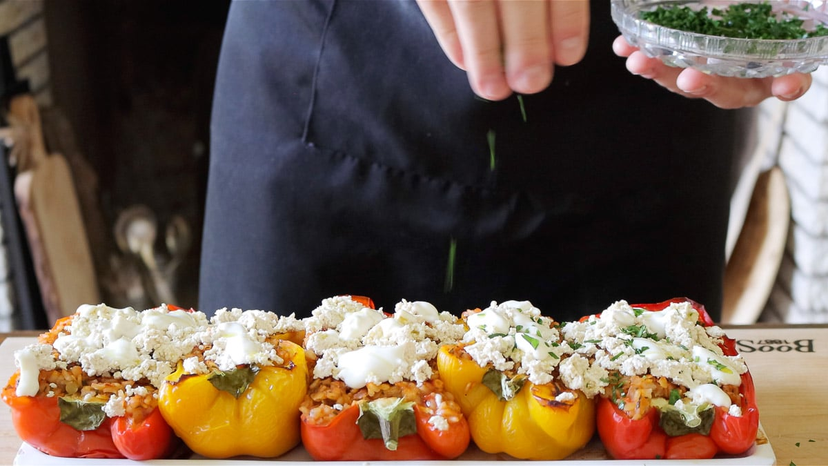 topping the peppers with vegan ricotta