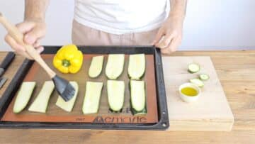 Prepping the zucchini and yellow pepper
