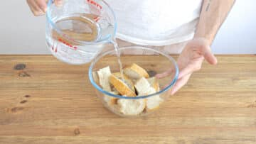 Soaking the bread with water and vinegar