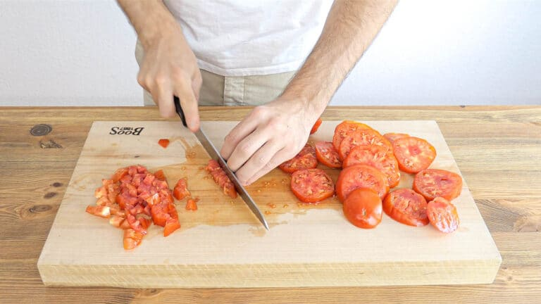 chopping the tomatoes in small dice