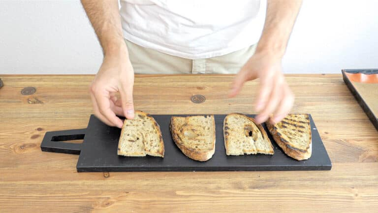 toasting the bread in the oven until crunchy and golden