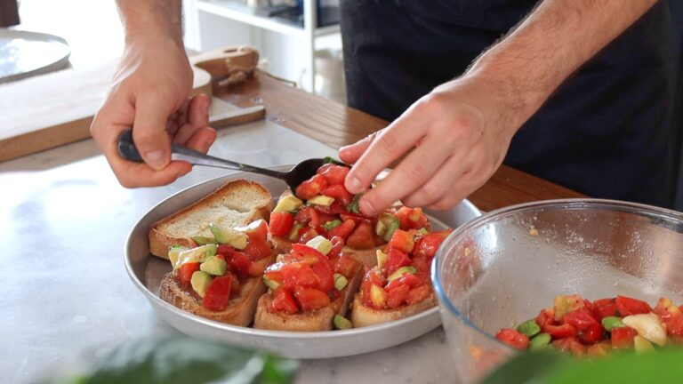 adding the tomatoes on to the bread