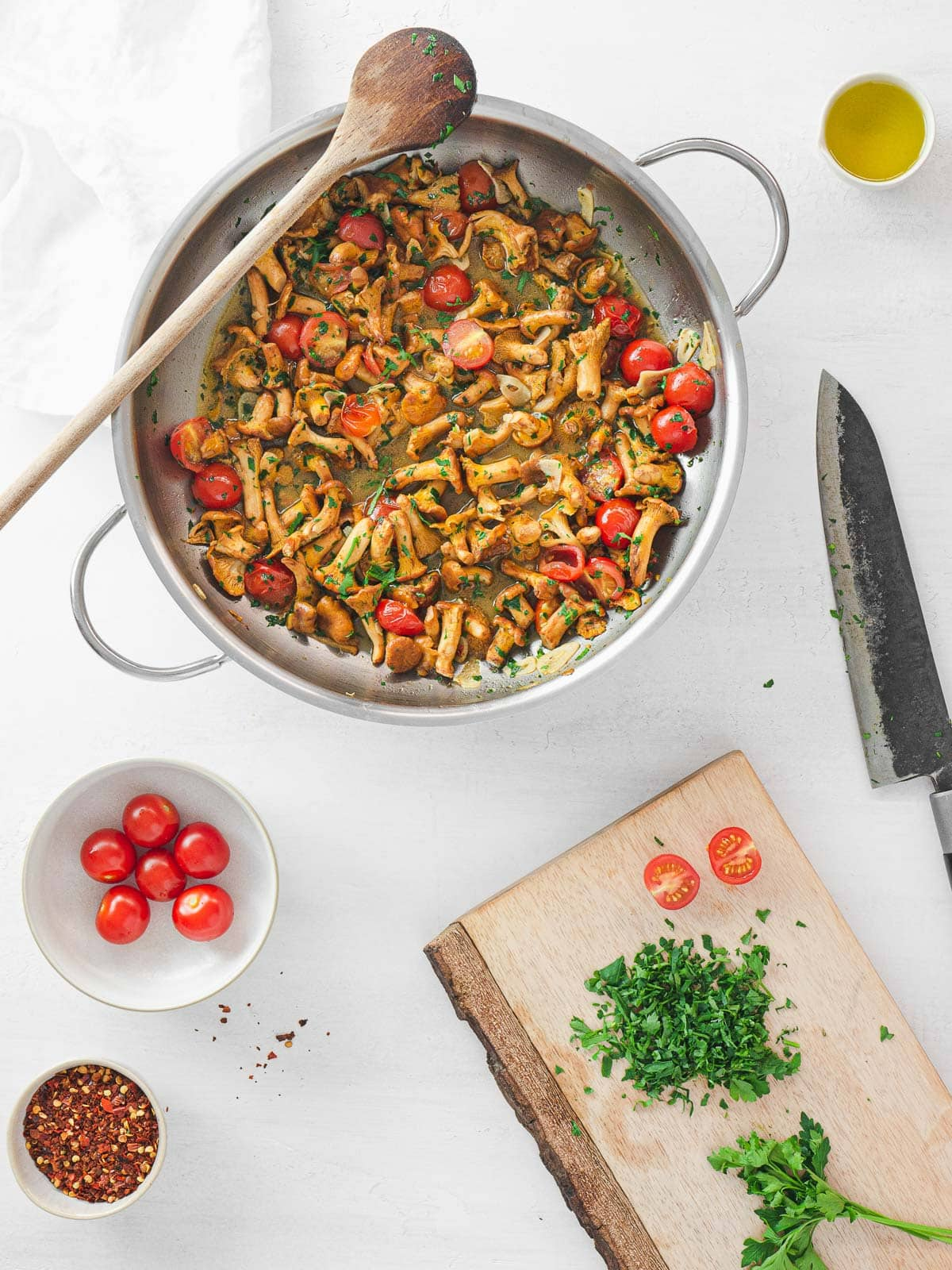 chanterelle cooked on a pan with tomatoes