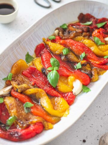 close up platter with roasted red and yellow peppers