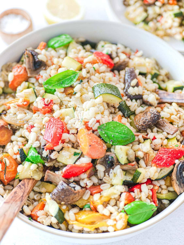 barley salad close up with plenty of roasted vegetables