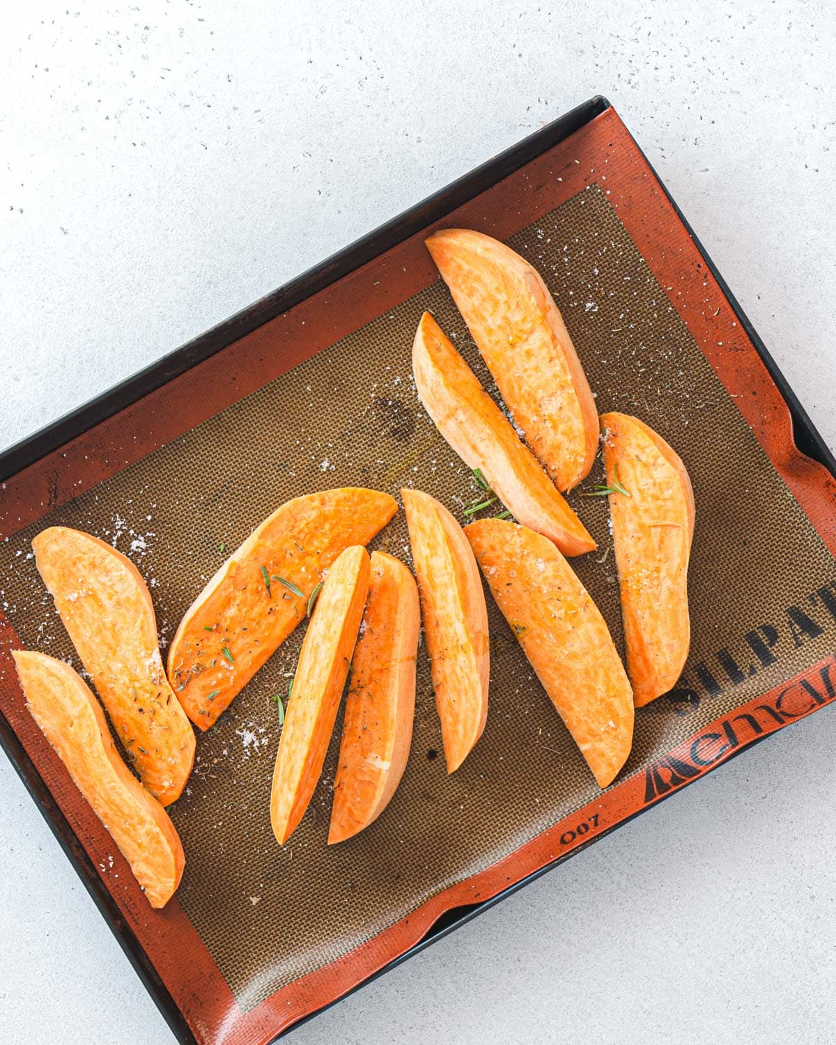 Sweet potatoo wedges ready to be baked