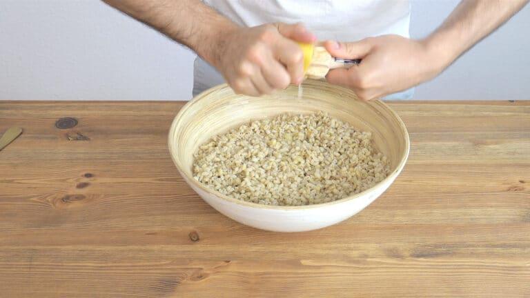 Squeezing lemon on the barley