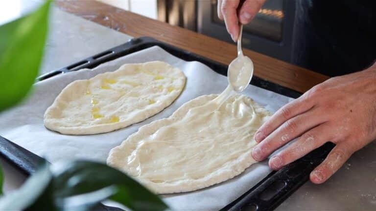 applying stracchino cheese