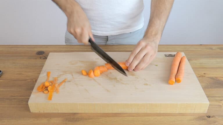 Cutting the carrots into small chunks