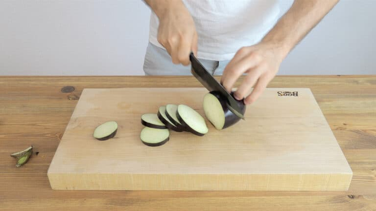 Cutting the eggplant into discs