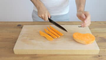 Cutting the sweet potato into wedges