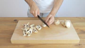Cutting each mushroom into 4
