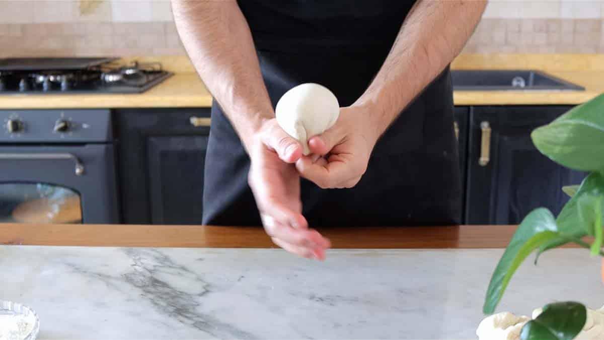 shaping dough into ball