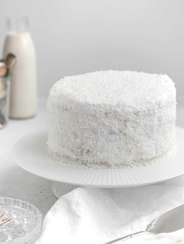 Whole vegan Sponge cake with coconut cream on platter