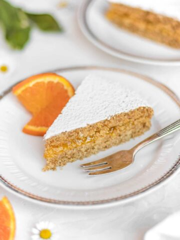 a slice of vegan orange curd cake