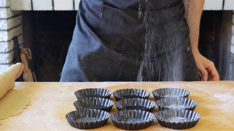 greasing the mini tart pans