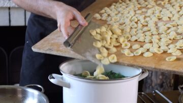 adding the homemade orecchiette to the boiling water
