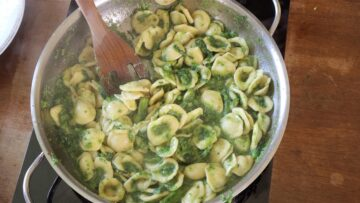 mixing the orecchiette with the sauce