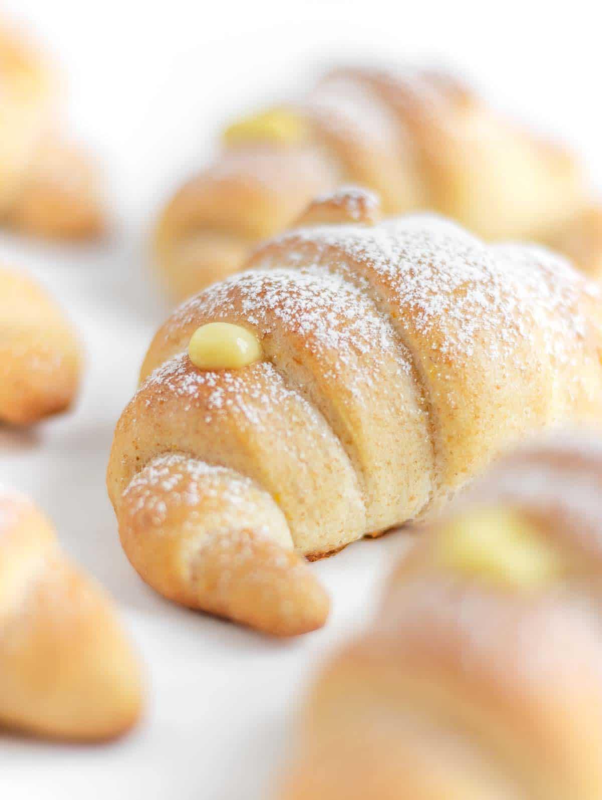 close up of Italian croissant with custard
