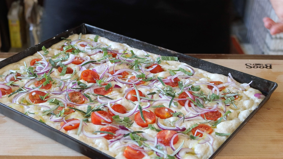 focaccia no knead with tomatoes and herbs