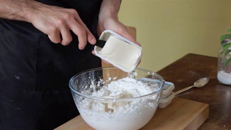 adding vegan cream cheese to the whipped cream