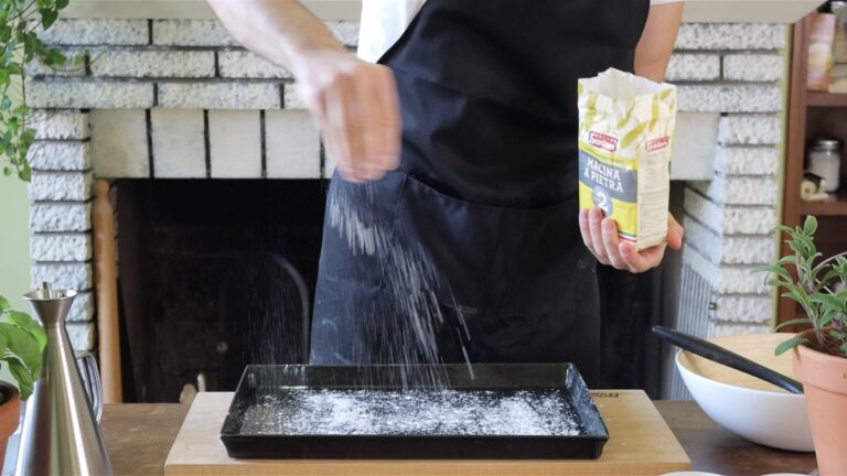 greasing the baking tray