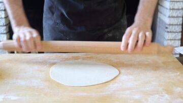 rolling the dough into a vegan piadina