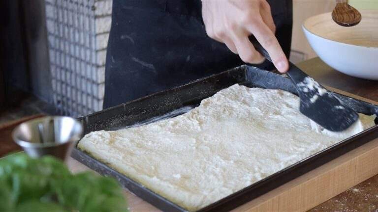 putting the dough in the tray