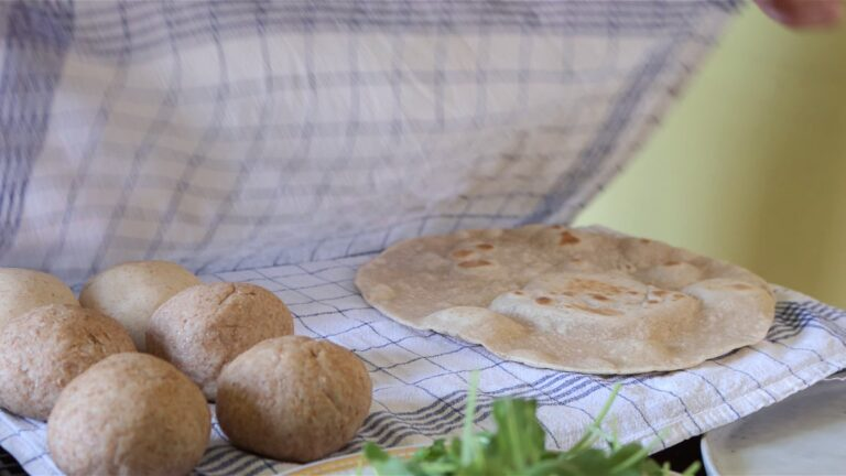 putting the flat-bread in between a cloth