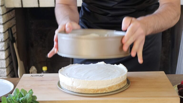 taking the vegan cheesecake out of the form