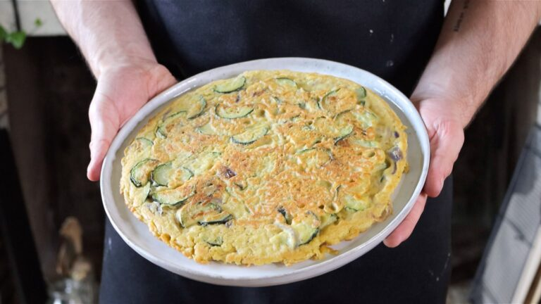 Serving the vegan chickpea frittata on a plate