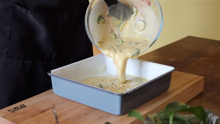 pouring the batter in the cake pan