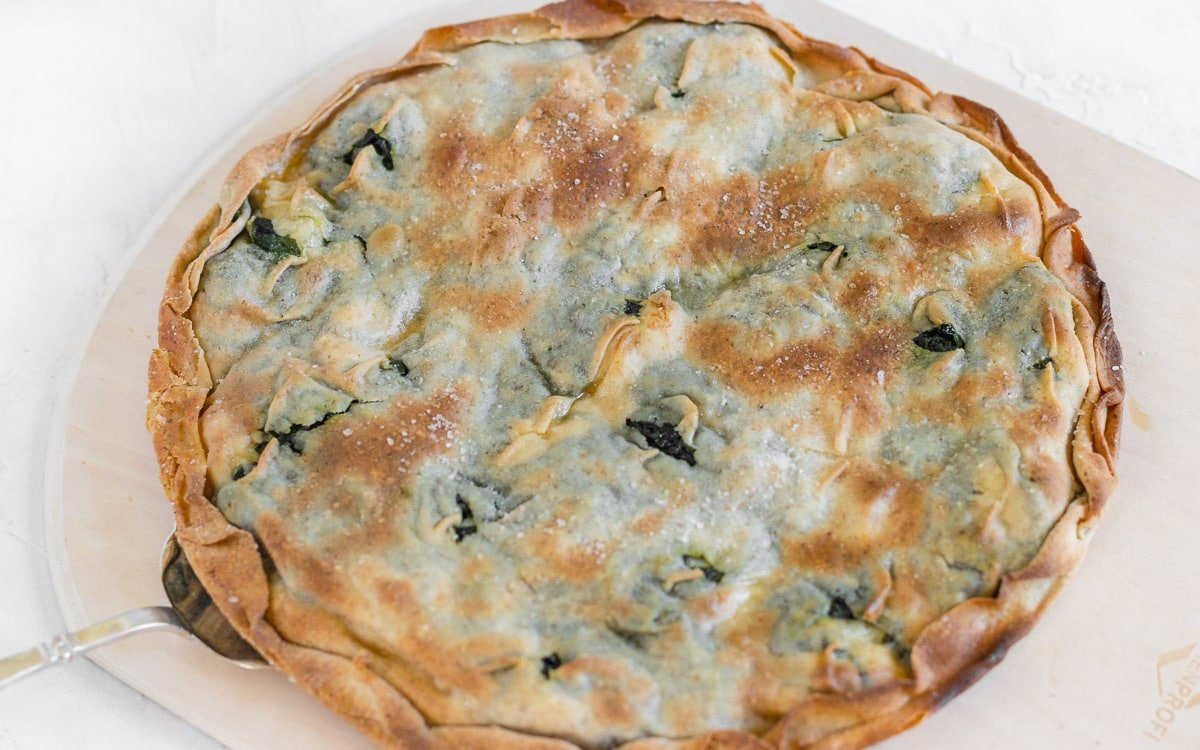 Thin Italian focaccia with vegan melted cheese and spinach