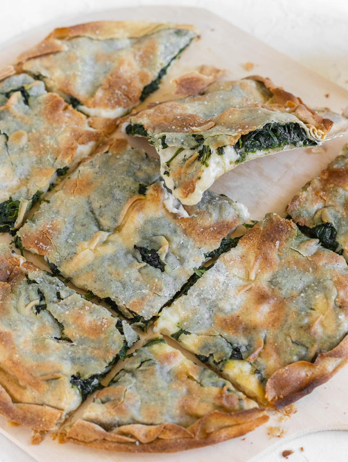crisp focaccia with vegan melted cheese and spinach