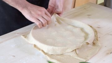 adding a sheet of rolled dough on top