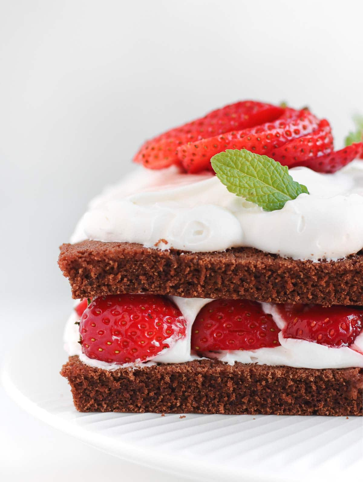 the edge of the chocolate and strawberry cake