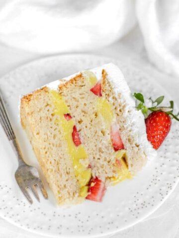 Slice of vegan vanilla cake strawberry chunks