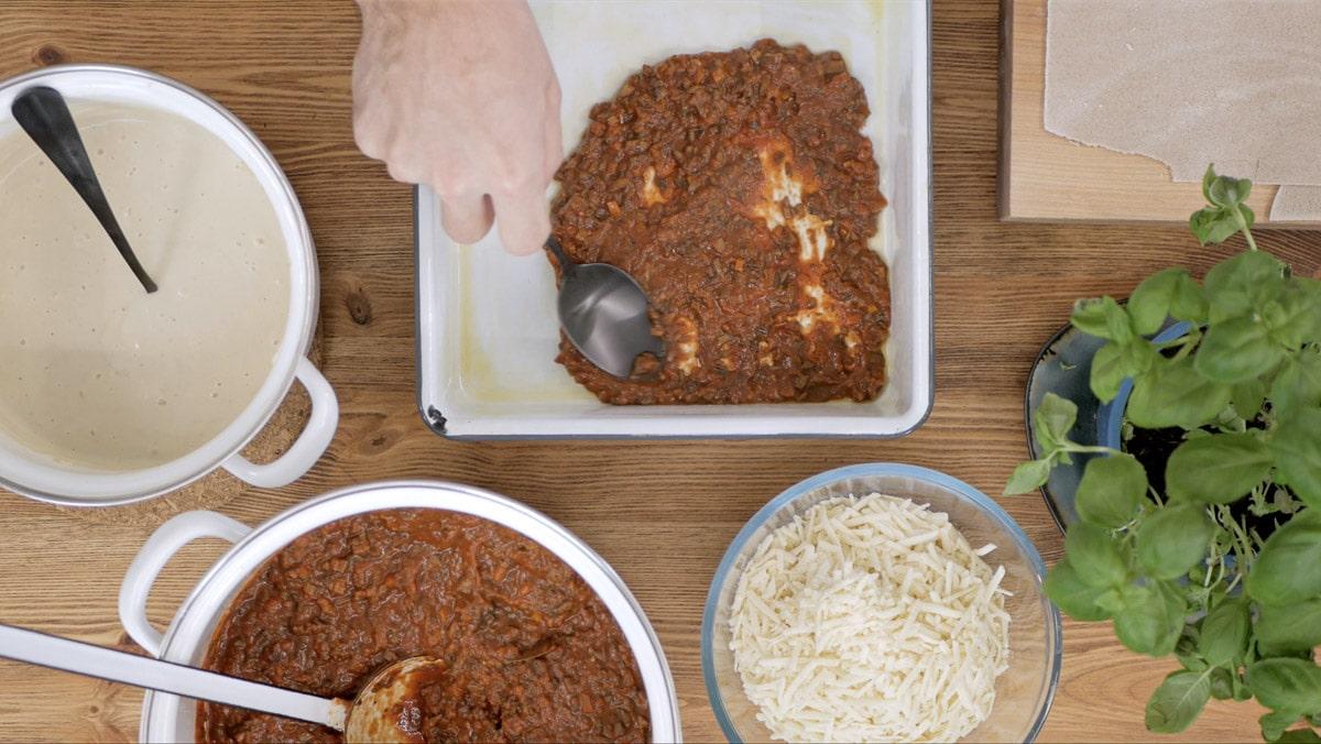 making lasagna with vegan bolognese