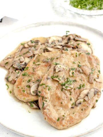 Vegan meat served with mushroom sauce on plate