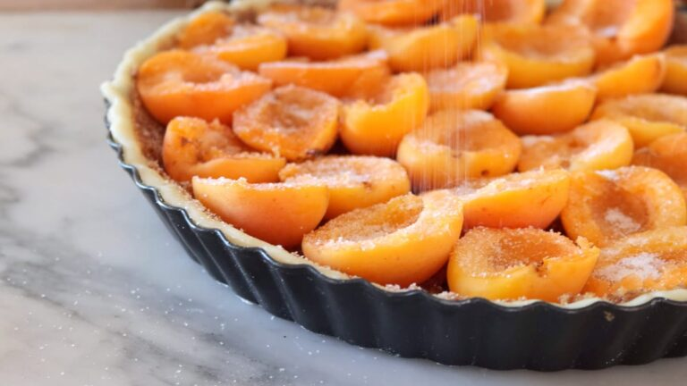 adding some sugar on top of the apricot tart