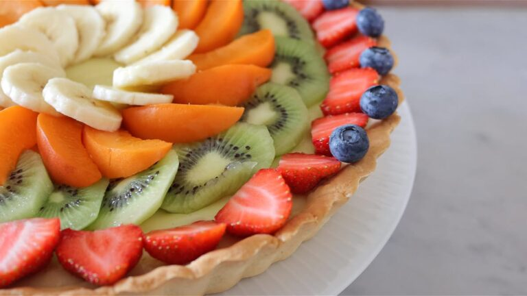 adding the fruit on top of the tart