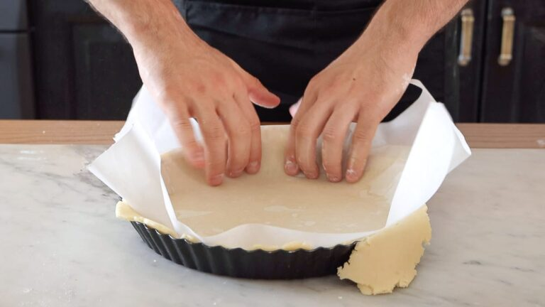 transferring the pie crust into the pie dish