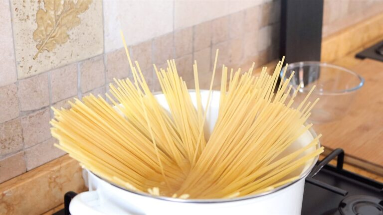 cooking the pasta in salted boiling water