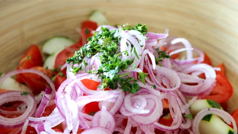 adding the chopped parsley on top of the salad